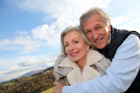 Portrait of happy senior couple in countryside Stock Photo - 8400921