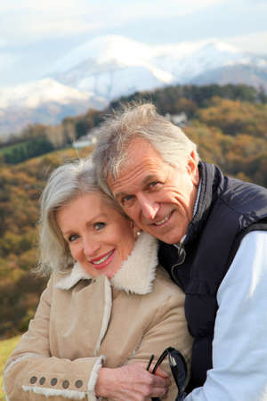 Portrait of happy senior couple in countryside photo