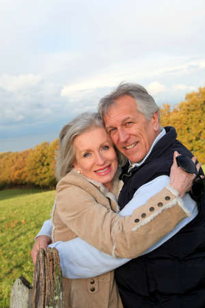 Happy senior couple embracing each other in countryside Stock Photo - 8401859