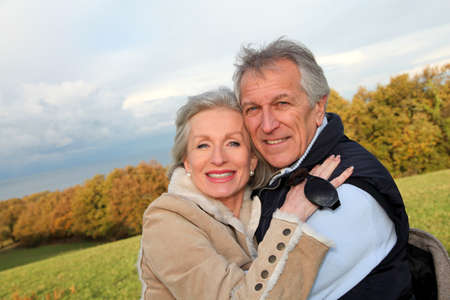 Happy senior couple embracing each other in countryside Stock Photo - 8400967