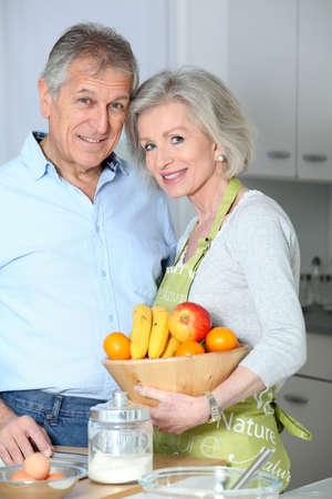 Closeup of happy senior couple in kitchen photo