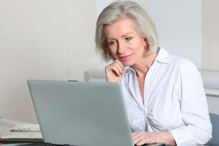 saleswomen: Senior businesswoman in the office Stock Photo