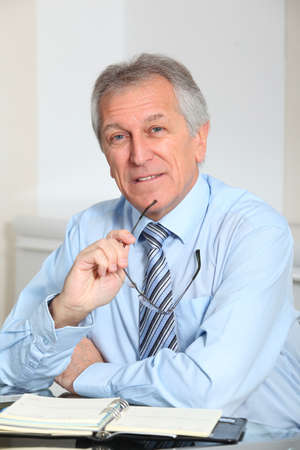 Portrait of senior businessman in office photo