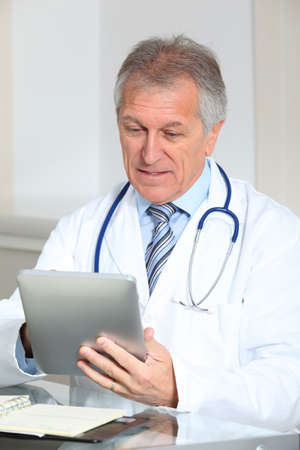 electronic pad: Closeup of doctor in the office with electronic pad