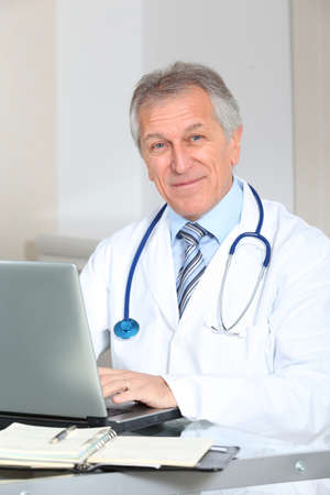 man doctor: Closeup of doctor working on computer in the office