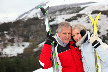 Senior couple at ski resort photo