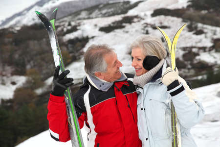 60s adult: Senior couple at ski resort