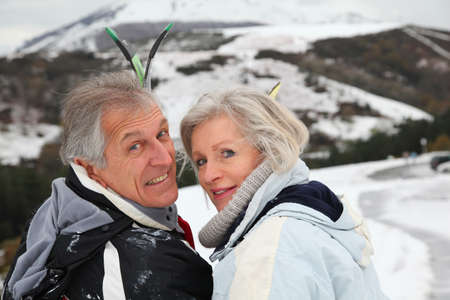 Portrait of senior couple in ski resort photo