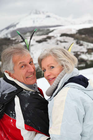 Portrait of senior couple in ski resort photo