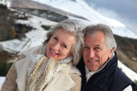 Portrait of happy senior couple at the mountain photo