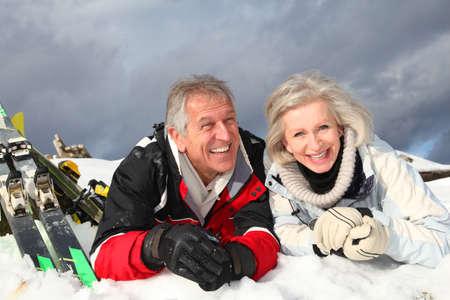 resorts: Senior couple having fun at ski resort