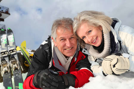 Senior couple having fun at ski resort Stock Photo - 8402100
