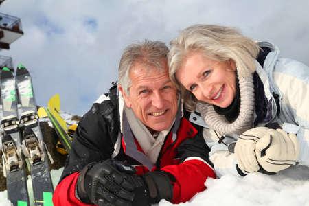 Senior couple having fun at ski resort Stock Photo - 8402100