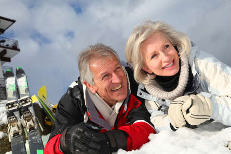 Senior couple having fun at ski resort photo