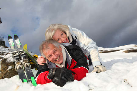 alpine skiing: Senior couple having fun at ski resort
