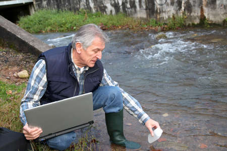 water quality: Hydrobiologist testing quality of water
