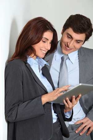 android tablet: Business people using electronic tab Stock Photo