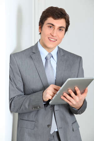 electronic pad: Businessman standing with electronic pad Stock Photo