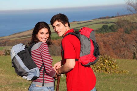 rambling: Couple hiking in countryside on beautiful fall day