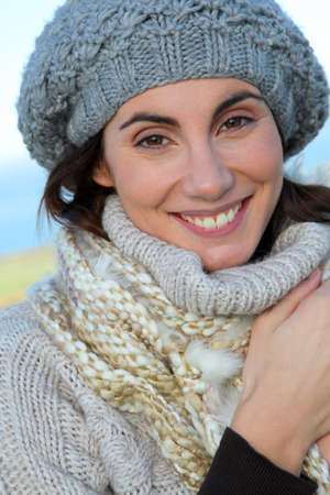 Portrait of beautiful smiling woman in winter photo
