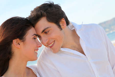 Portrait of lovely couple at the beach in summer photo