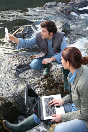 Biologists testing water of natural river photo