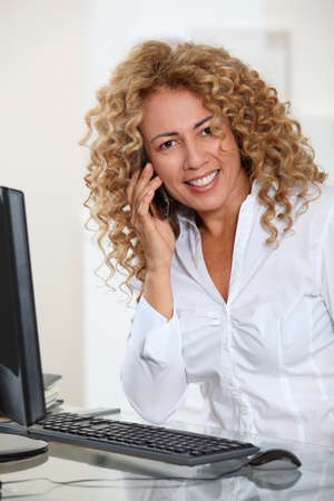 mobilephone: Portrait of businesswoman with mobilephone