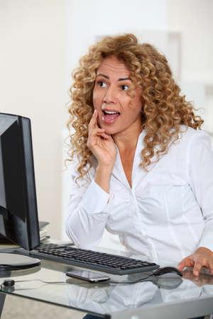 Portrait of surprised businesswoman photo