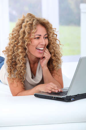Woman at home using laptop computer photo