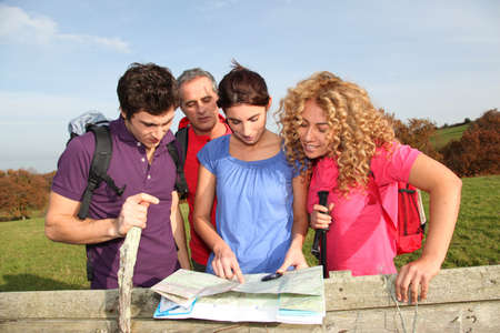 rambling: Group of friends hiking in countryside