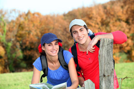 hiking stick: Young couple hiking in countryside