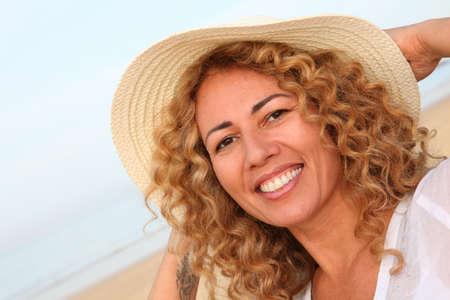 Portrait of beautiful blond woman wearing hat photo