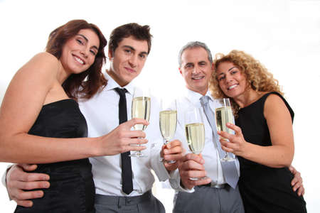 Group of friends cheering with glasses of champagne Stock Photo - 8740477