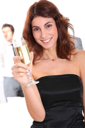 Beautiful smiling woman holding glass of champagne Stock Photo - 8741051