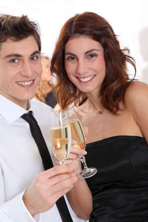 Couple celebrating new year's eve with champagne Stock Photo - 8741871