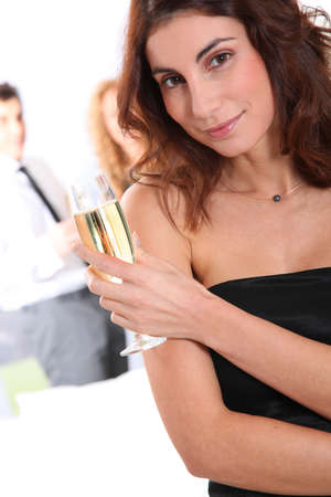 Beautiful smiling woman holding glass of champagne Stock Photo - 8741049