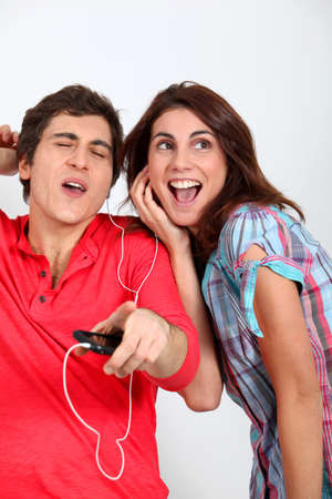 Couple having fun listening to music player photo