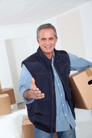 Removal man holding boxes photo