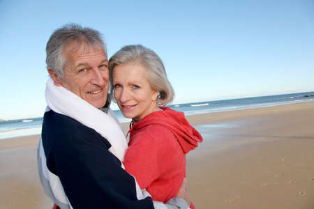 Senior couple exercising by the sea photo