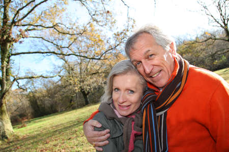 Closeup of senior couple in countryside photo