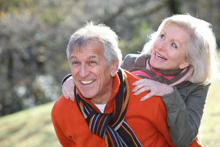 Senior couple having fun in countryside photo