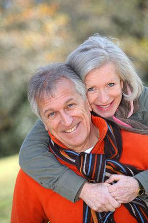 Senior couple having fun in countryside photo