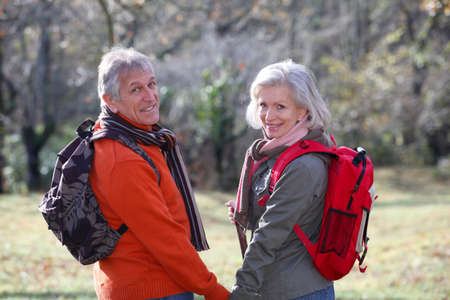 Closeup of senior couple hiking in countryside photo
