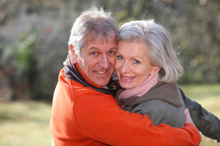 Portrait of senior couple in countryside photo