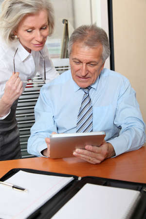 electronic pad: Senior business people in the office with electronic pad