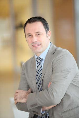 Portrait of smiling businessman with grey suit Zdjęcie Seryjne