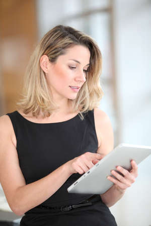 Businesswoman using electronic tab Stock Photo - 8974080