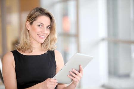 Businesswoman using electronic tab Stock Photo