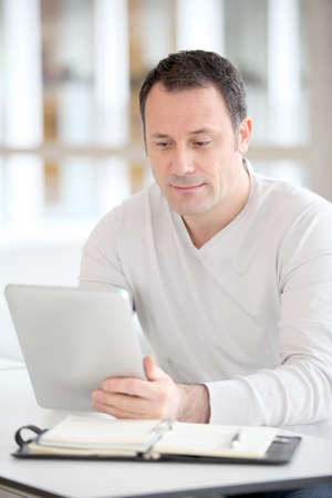 android tablet: Office worker in the office using electronic tab Stock Photo