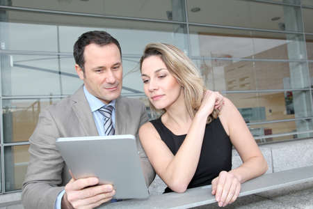electronic pad: Business partners working on electronic pad